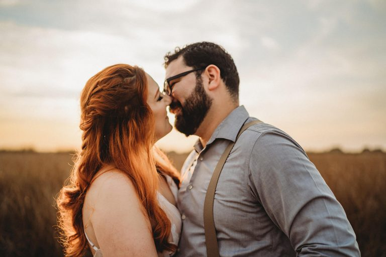 golden hour elopement photograph by New Orleans Elopement Photographer. Couple kissing with a glow of light at Fontainebleau State Park in Mandeville, LA