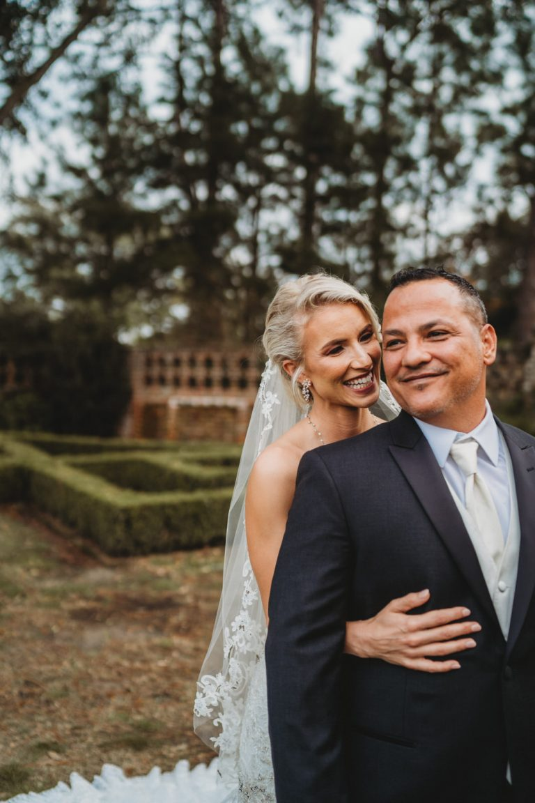 Couple wearing their wedding attire at Longue Vue House and Gardens for New Orleans Elopement Photographer