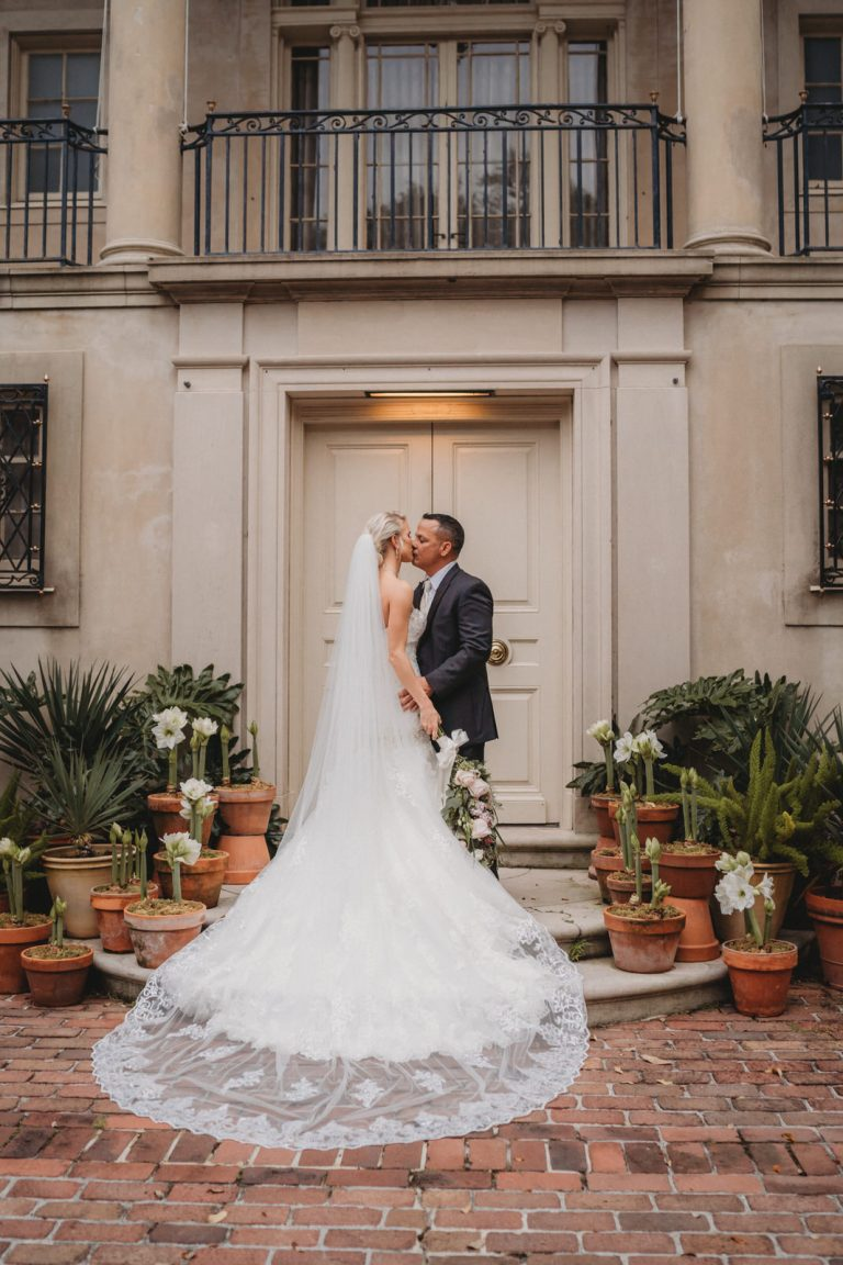 Boho couple posing at Longue Vue Gardens by New Orleans Elopement Photographer