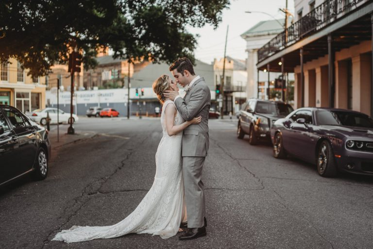 Eloping Couple Kissing at Sunset near Il Mercato for New Orleans Elopement Photographer